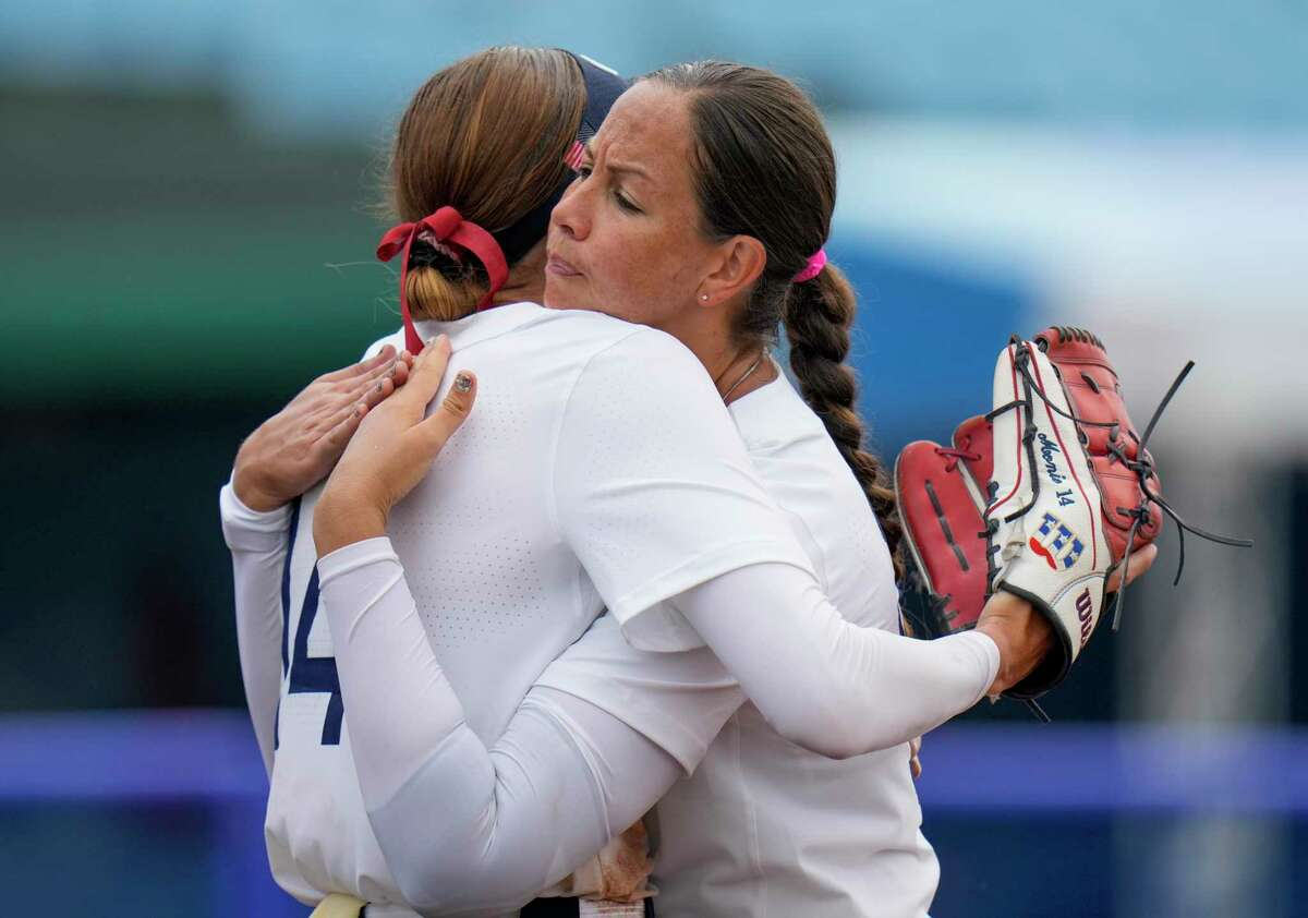 Teammates United States' Monica Abbott, left, and Cat Osterman embrace after defeating Canada in their softball game at the 2020 Summer Olympics, Thursday, July 22, 2021, in Fukushima , Japan. (AP Photo/Jae C. Hong)