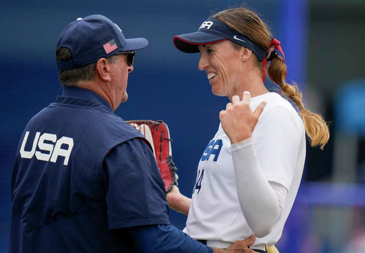 United States head coach Ken Eriksen celebrates with Monica Abbott after defeating Canada in their softball game at the 2020 Summer Olympics, Thursday, July 22, 2021, in Fukushima , Japan. (AP Photo/Jae C. Hong)