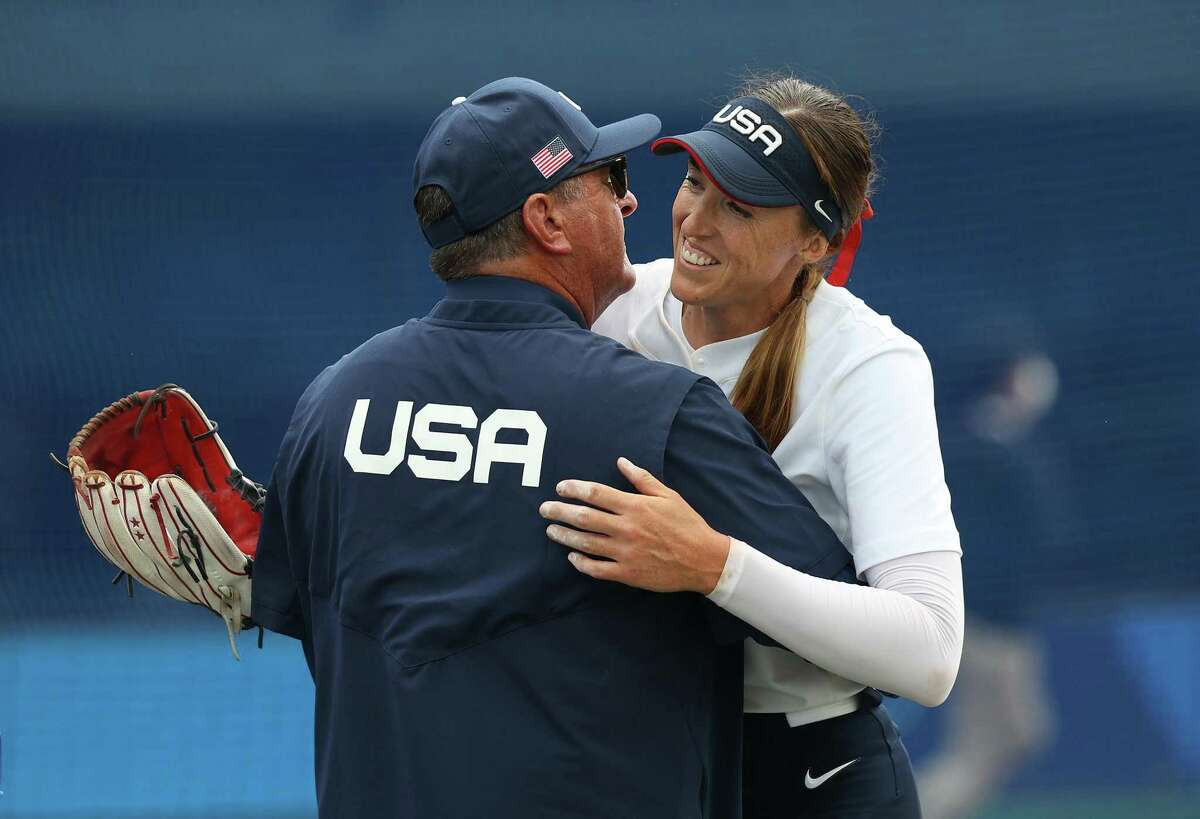 FUKUSHIMA, JAPAN - JULY 22: Pitcher Monica Abbott #14 of Team United States hugs Team United States head coach Ken Eriksen after their game against Team Canada during the Softball Opening Round of the Tokyo 2020 Olympic Games at Fukushima Azuma Baseball Stadium on July 22, 2021 in Fukushima, Japan. Team United States defeated Team Canada 1-0. (Photo by Yuichi Masuda/Getty Images)