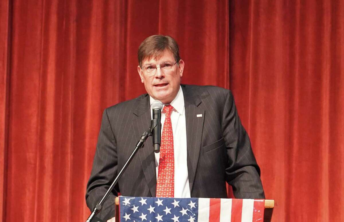 Rep. Tom O'Dea read off the vote counts at the Republican caucus at the New Canaan High School on July 21, 2021. It had a turnout of nearly 1,000 people.
