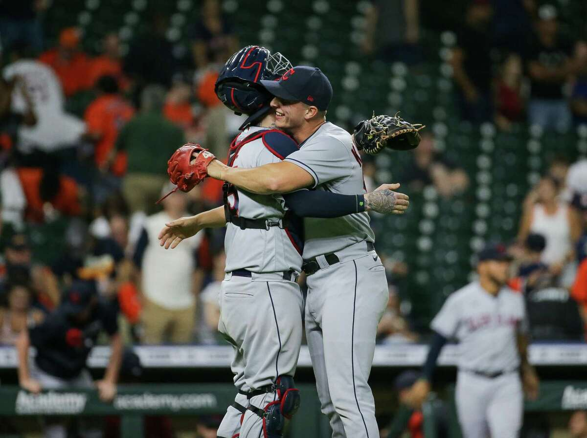 Cleveland relief pitcher James Karinchak (99) celebrates with catcher Roberto Perez (55) after earning the save against the Houston Astros during an MLB game at Minute Maid Park on Wednesday, July 21, 2021, in Houston. Cleveland won 5-4.