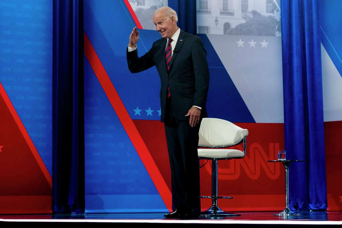 President Joe Biden interacts with members of the audience during a commercial break for a CNN town hall at Mount St. Joseph University in Cincinnati, Wednesday, July 21, 2021.