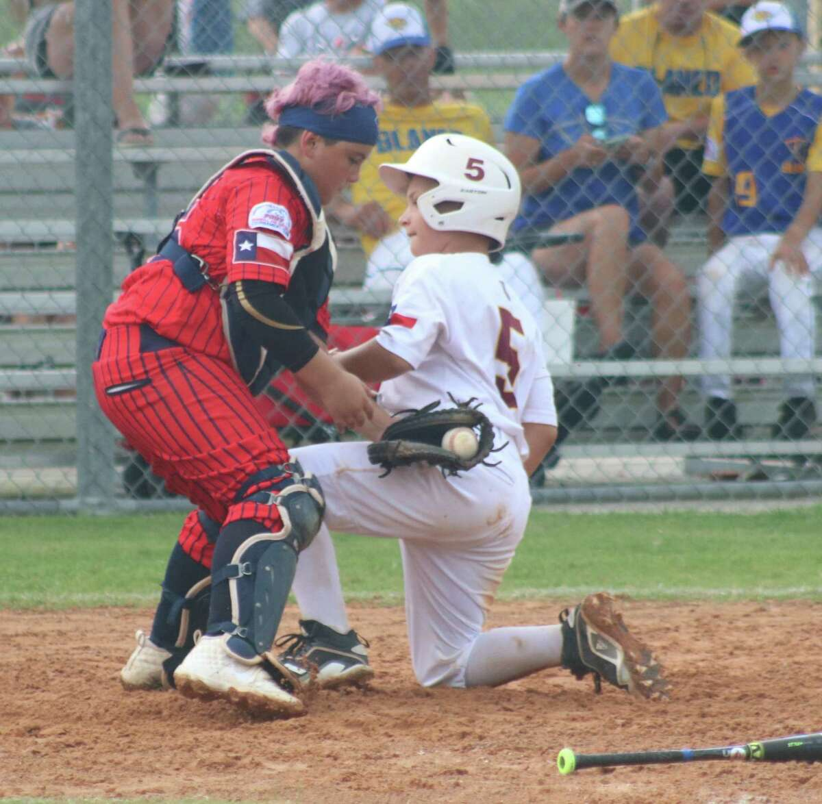 Deer Park's Aiden Gorom scores the team's third run against the Devin Braves during first-inning action Wednesday at the Ruth Minchen Athletic Complex.