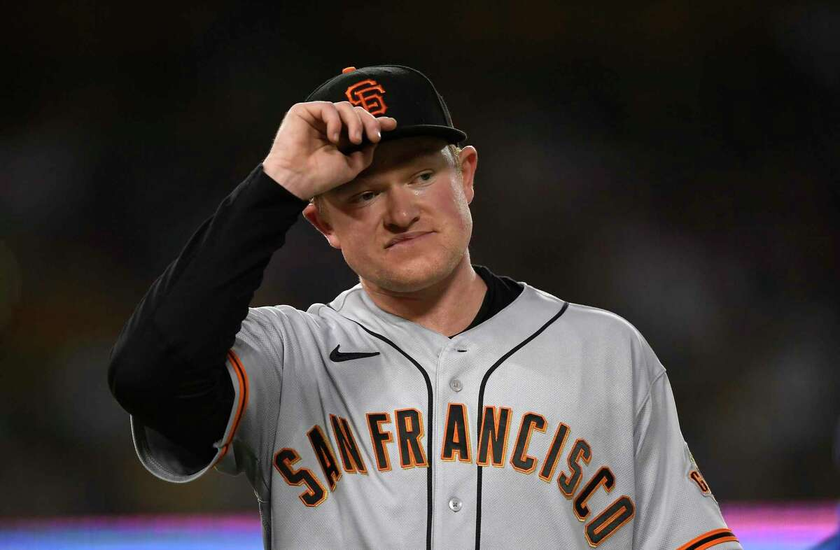 LOS ANGELES, CA - JULY 21: Starting pitcher Logan Webb #62 of the San Francisco Giants reacts after giving up a run against the Los Angeles Dodgers during the fourth inning at Dodger Stadium on July 21, 2021 in Los Angeles, California. (Photo by Kevork Djansezian/Getty Images)