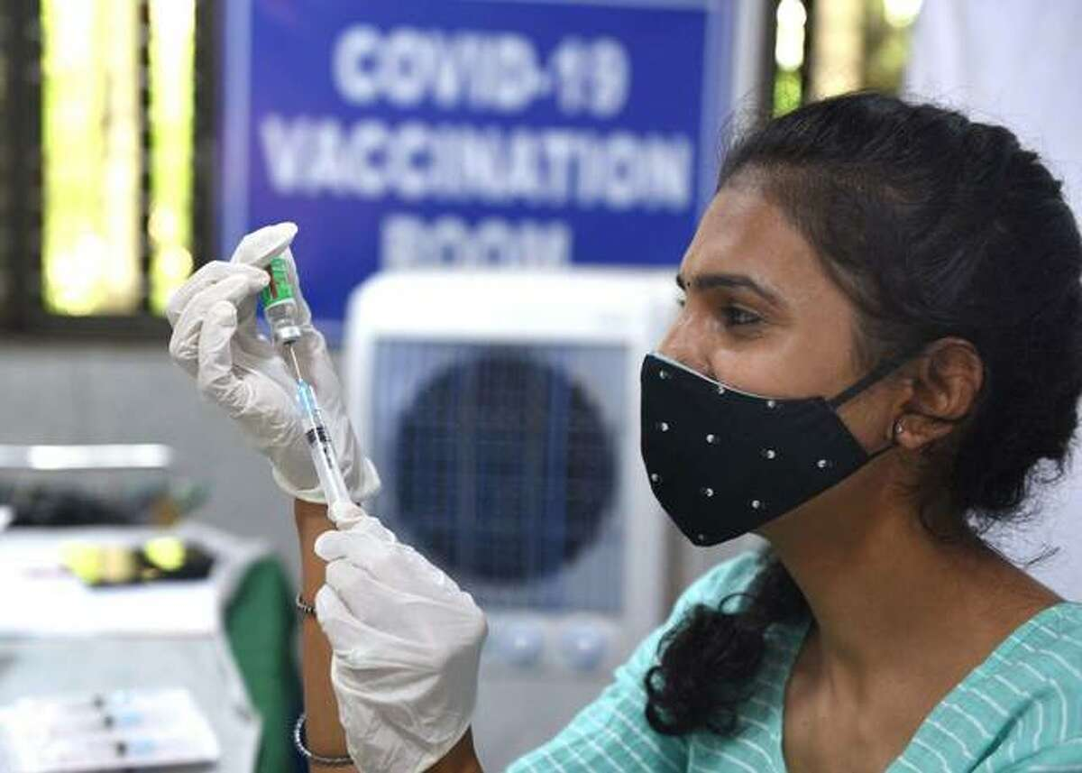 A health worker prepares a dose of vaccine Tuesday.