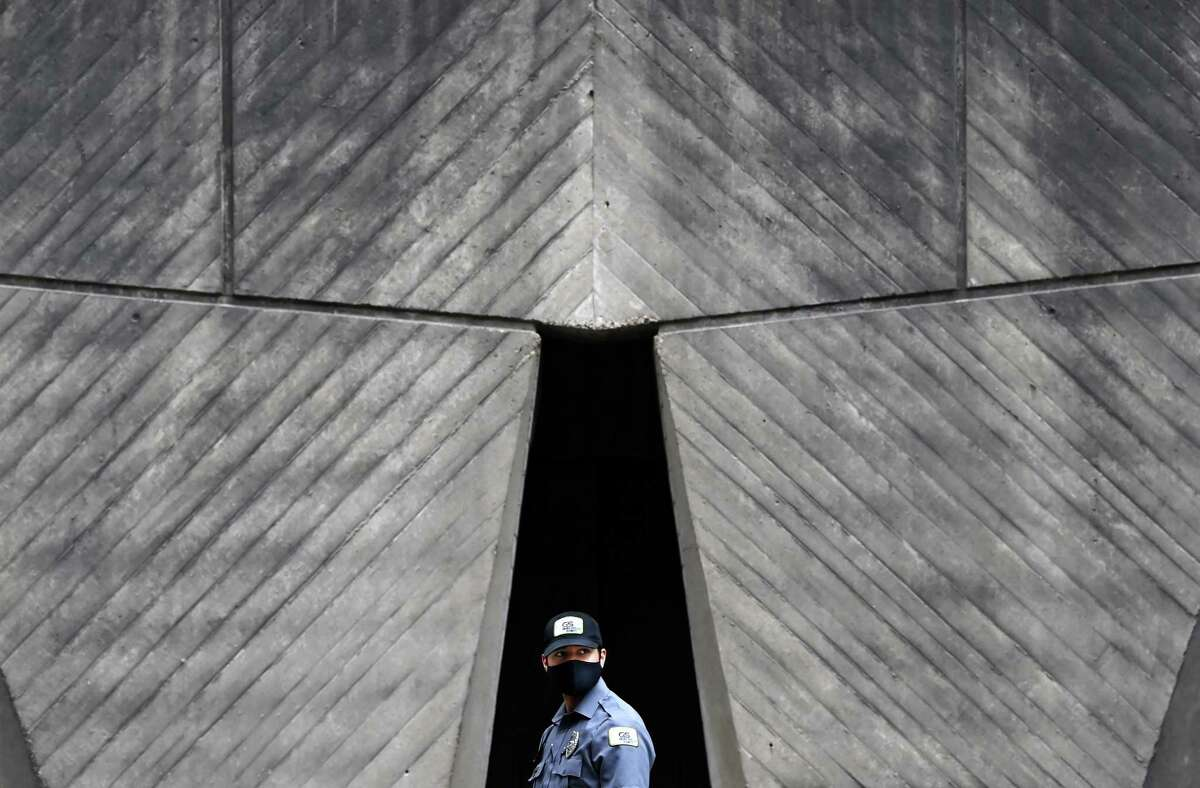 A security member walks outside the Department of Housing and Urban Development on May 17 in Washington.