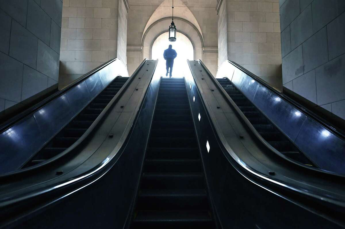 A rider exits the Federal Triangle Metro station on Dec. 1 in Washington.
