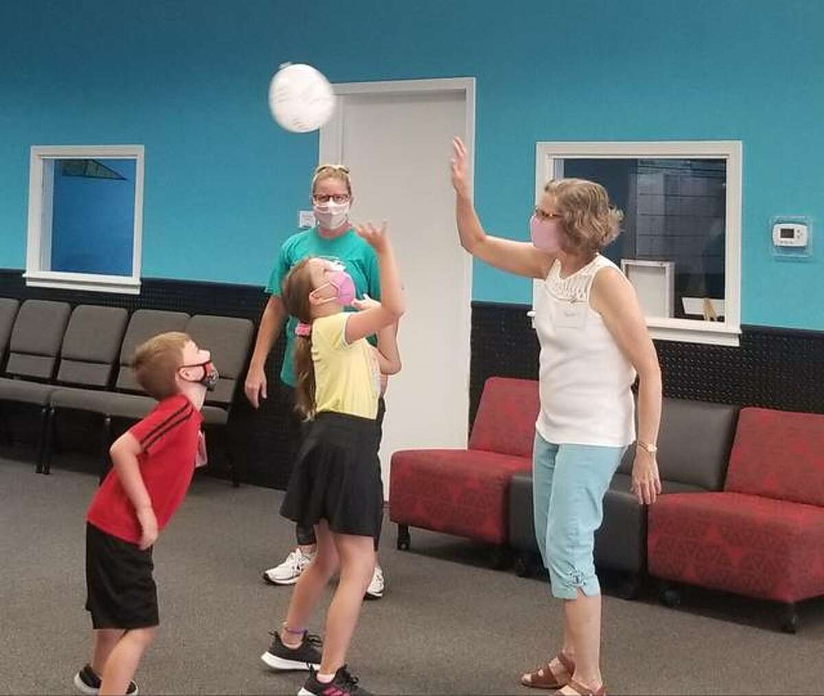 Tuesday's camp began with an ice breaker game where students had to keep a balloon in the air. Children practiced reading and learned the 10 Commandments when they had to read one of the commandments written if the balloon hit the floor.