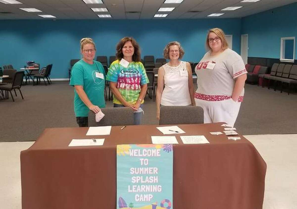 Angie Claypool, Kim Miller, Bobbie Aden and Winter Tolly volunteer their time Tuesdays and Thursdays to help tutor children at The Bridge Church in Glen Carbon.