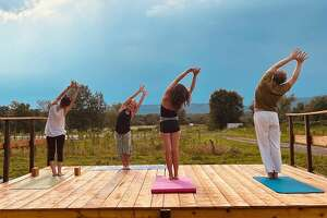 """Taliaferro Farms hosted its first on-farm yoga class this July. Farmer Pete Taliaferro was on his tractor during the first session and was asked to be quiet. """"I got the message,"""" he laughed."""