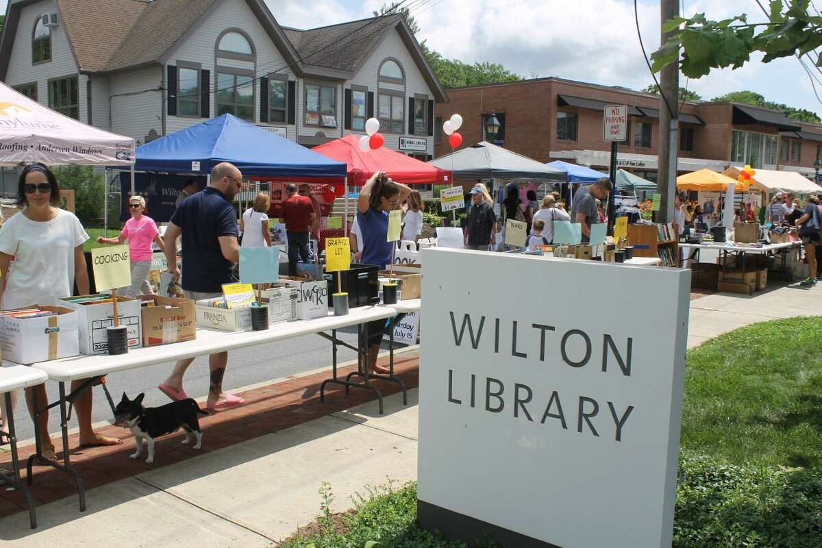 The Wilton Library is holding its Summer Sidewalk Book Sale on Saturday, July 24, from 10 a.m. to 3 p.m., during the Wilton Sidewalk Sale and Street Fair. The sale offers gently used books for beach, and vacation reads, children's books, teen books, cookbooks, history books, classic books, gardening, paperbacks, an Art Shoppe, and more. Smart shoppers will also find an assortment of CDs, (Compact Discs), and DVDs, (Digital Video Discs), vinyl records, puzzles, and a Tag Sale that will be stretching from one end of the library's front lawn to the other. There will also be bargains, and something for all people who attend the event, from babies to senior citizens. The sale moves inside to the library's Gallery, on Monday, July 26, where is it going to be through Thursday, July 29, during the library's regular hours, which are: Monday through Friday, from 10 a.m. to 6 p.m. The library is located at 137 Old Ridgefield Road in the town. The library's website is www.wiltonlibrary.org. The library's main phone number is (203) 762-3950.
