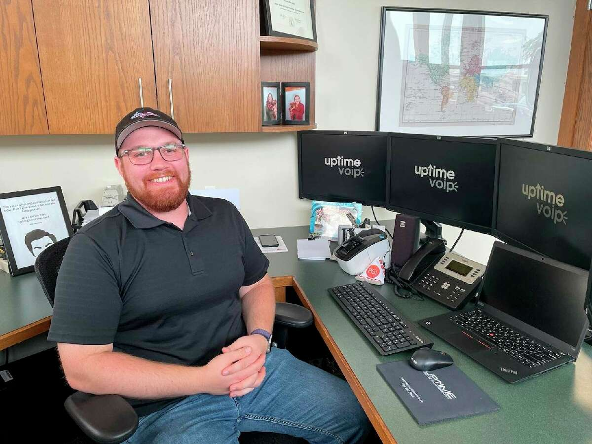 Pictured is Blaine Yeager, who owns Uptime VoIP, a phone company in Coleman. (Photo provided)
