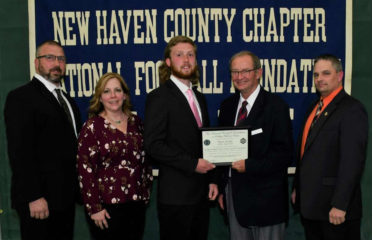 Shelton football player Ryan Kudej with parents David and Vivian, scholar athlete chairman Kevin O'Brien and Shelton coach Mike DeFelice was honored by the Casey-O'Brien New Haven County Chapter of the National Football Foundation and College Hall of Fame.