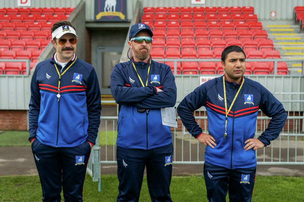 """(L-r) Jason Sudeikis, Brendan Hunt and Nick Mohammed in """"Ted Lasso,"""" returning for its second season July 23."""