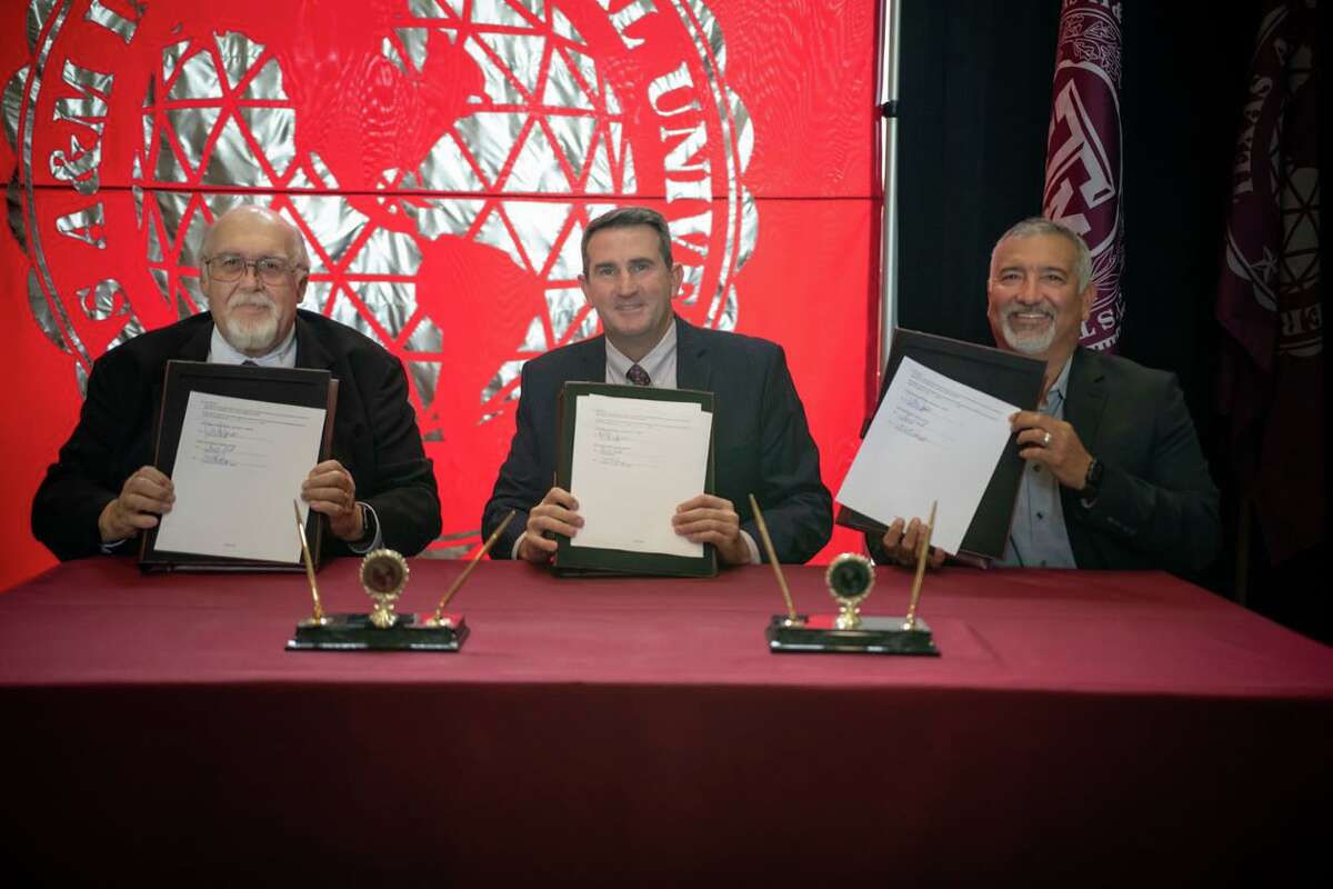 Holding the signed agreements that will drive an Early College High School Program between Freer Independent School District and TAMIU are, left to right, TAMIU president Dr. Pablo Arenaz; Freer ISD Board president Steve McQuagge and Freer ISD superintendent Conrad Cantú.