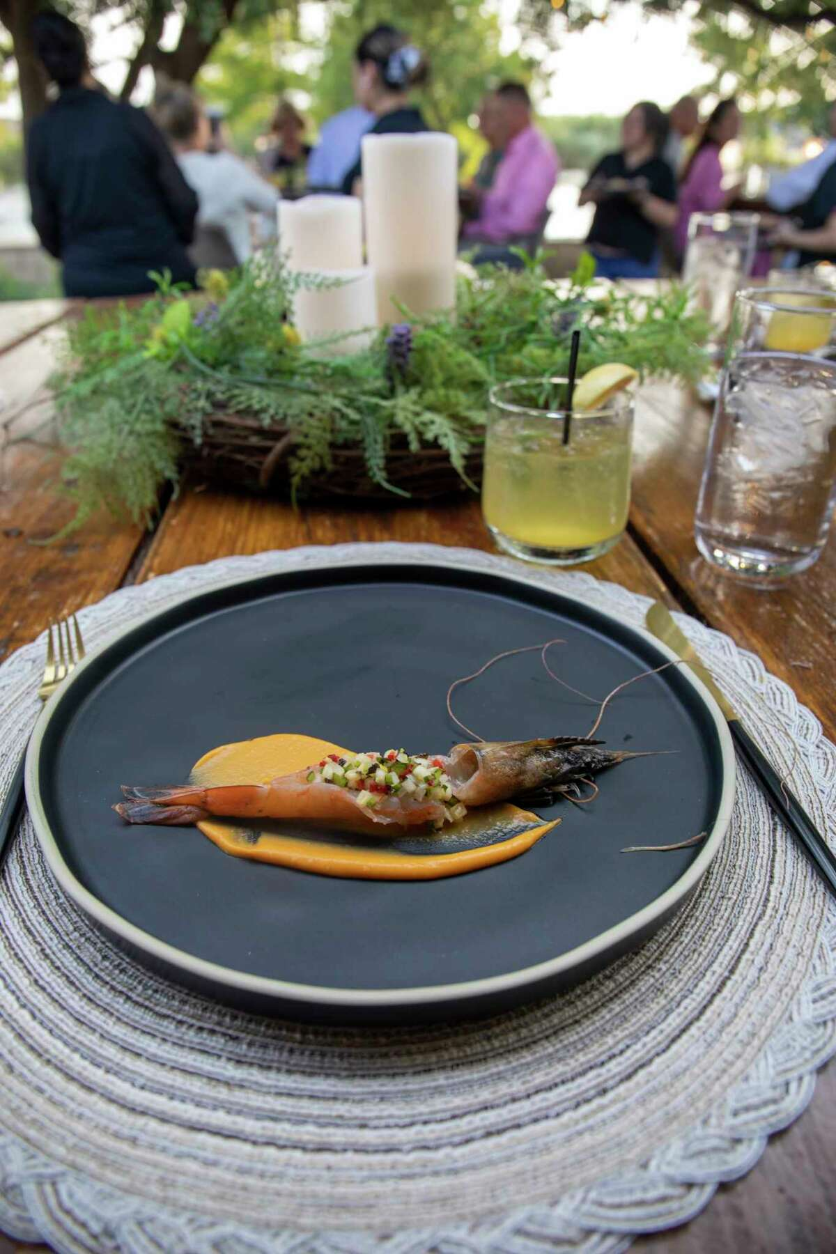 Sweet potato purée, New Caledonia blue prawn, apple, scallion, parsley oil paired with Lilikoi and mint spritzer during Seance's first dinner Monday, July 19, 2021 at Shack in the Back. Jacy Lewis/Reporter-Telegram