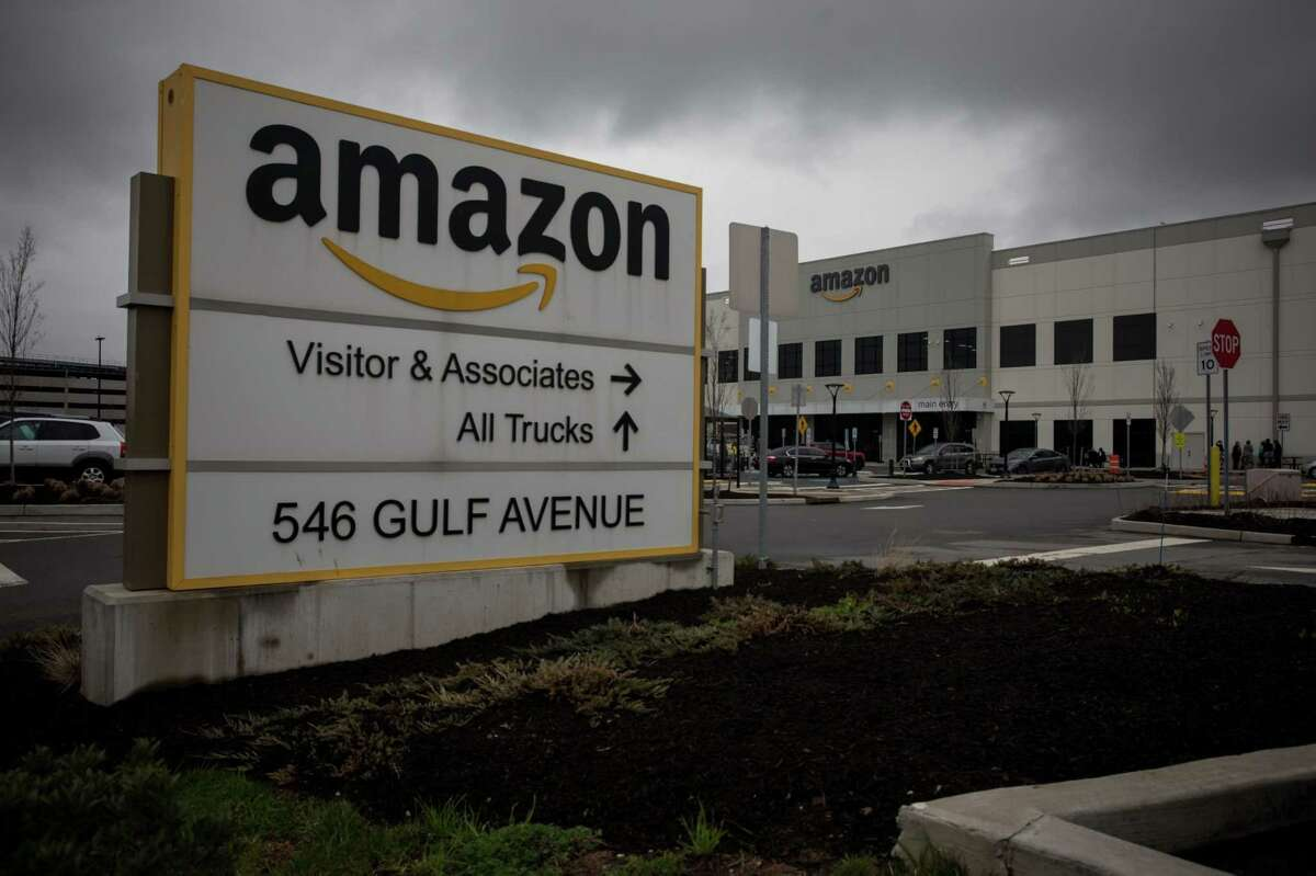 Amazon.com signage in front of a warehouse in the Staten Island borough of New York on March 31, 2020.