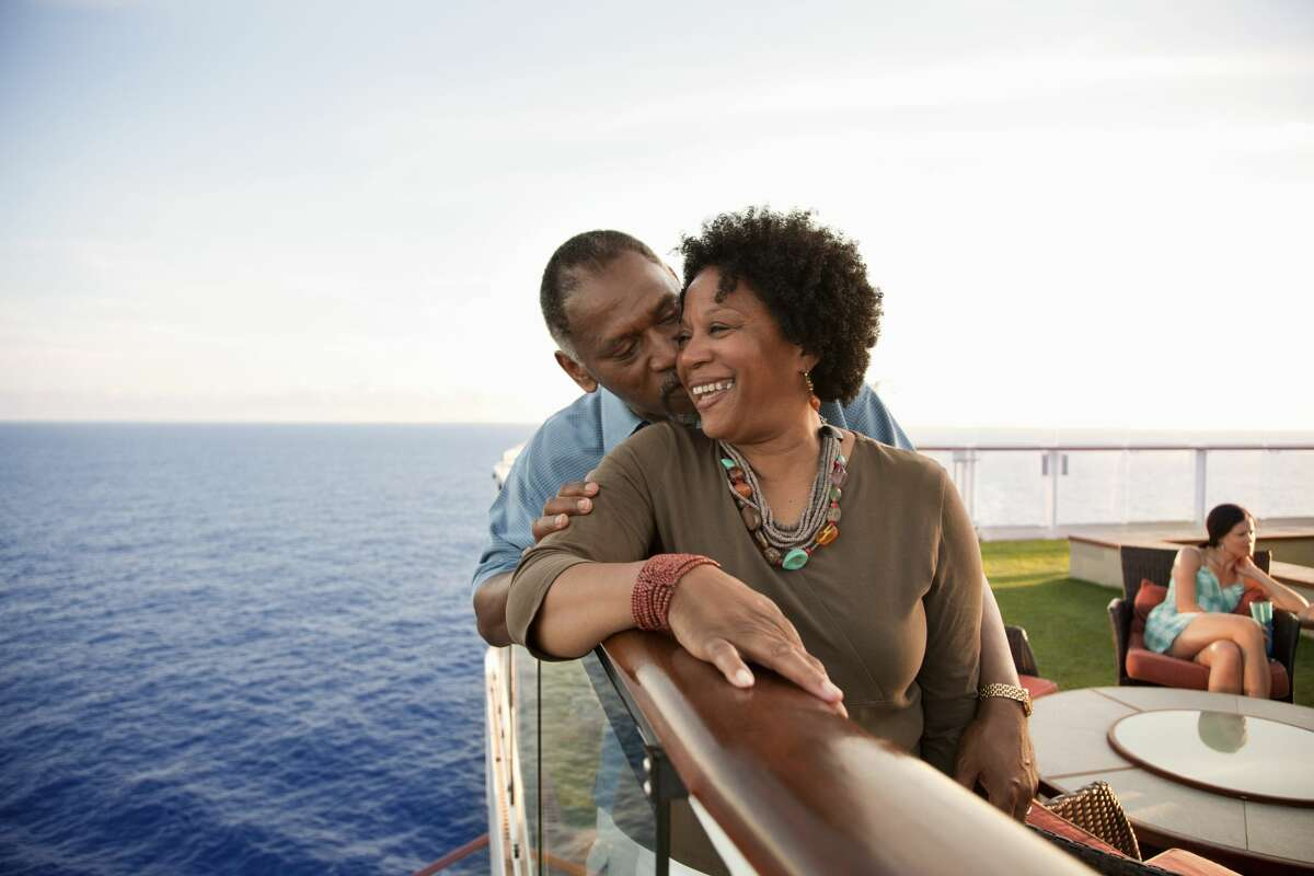 A couple enjoys the view on a cruise vacation.