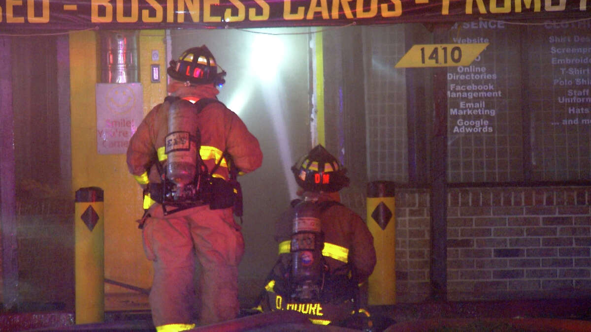 Officials haven't determined what caused an early morning fire that destroyed two Northwest Side businesses Thursday.