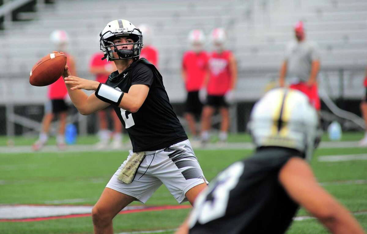 Trumbull QB Hunter Agosti throws during the Grip It and Rip It 7-on-7 football tournament in New Canaan on July 10.