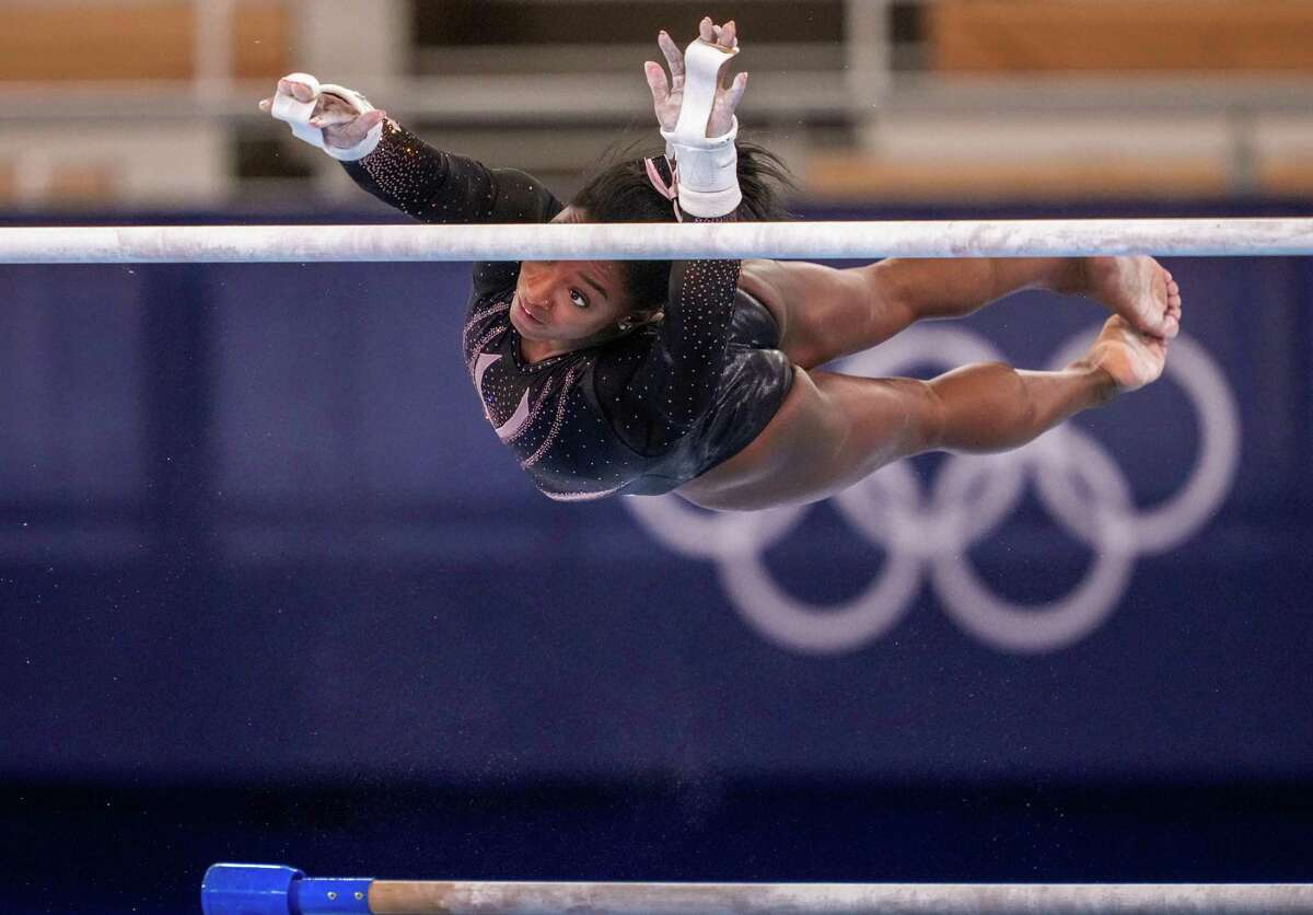 United States Olympic gymnast Simone Biles practices the uneven bars at Ariake Gymnastics Centre in Tokyo on July 22, 2021, ahead of the postponed 2020 Tokyo Olympics. (Chang W. Lee/The New York Times)