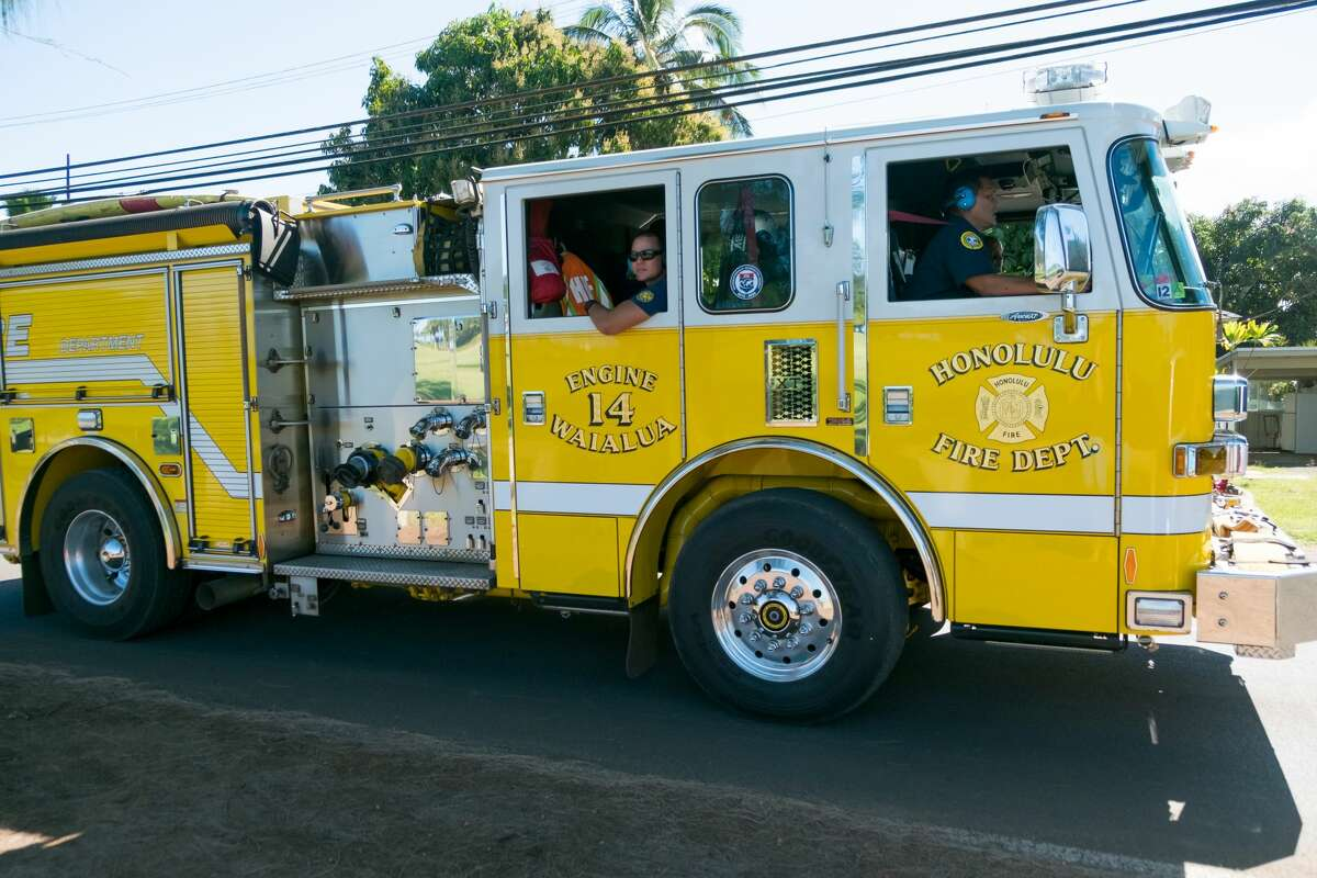 FILE - Honolulu Fire Department heads back to the station after responding to an incident.