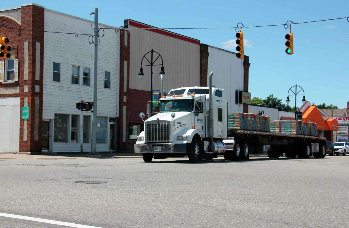 A truck crosses the intersection of Huron Avenue and Port Crescent Street in Bad Axe on a sunny afternoon July 21. (Teresa Homsi/Huron Daily Tribune)