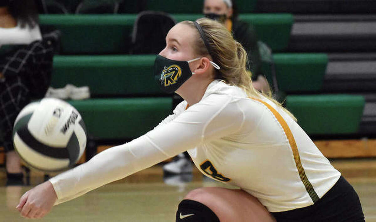 Metro-East Lutheran senior Chloe Langendorf successfully receives a serve during a match this past season inside Thomas Hooks Gym.