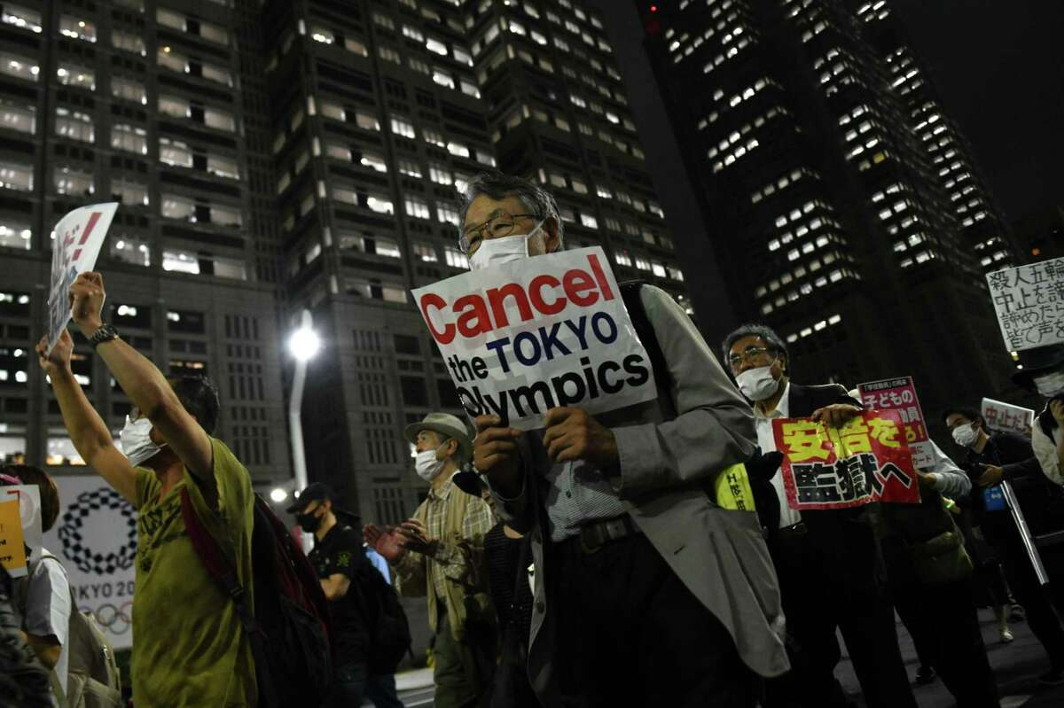An anti-Olympic protest in Tokyo on June 23. MUST CREDIT: Bloomberg photo by Noriko Hayashi.