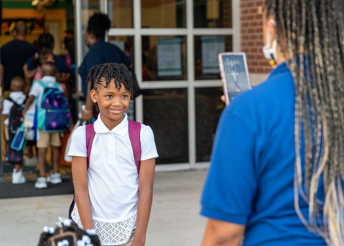 Students at Clark Intermediate School in Spring ISD arrive for their first day of school Monday, July 19, 2021.