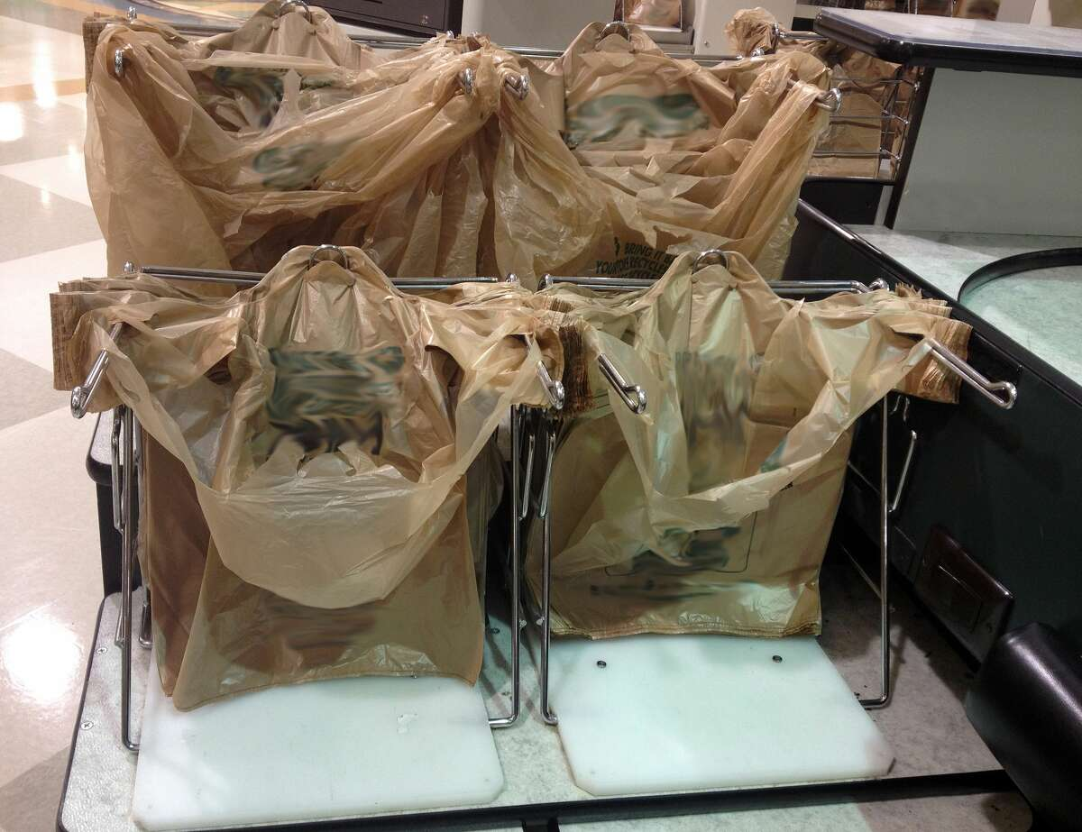 Plastic bags at grocery store checkout counter.