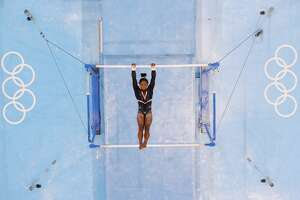 TOKYO, JAPAN - JULY 22: Simone Biles of Team United States trains on uneven bars during Women's Podium Training ahead of the Tokyo 2020 Olympic Games at Ariake Gymnastics Centre on July 22, 2021 in Tokyo, Japan. (Photo by Richard Heathcote/Getty Images)