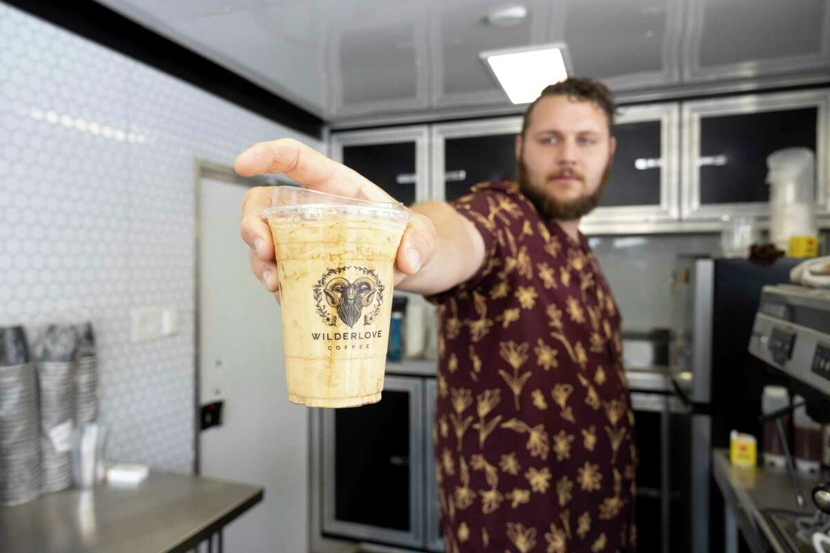 Kade Jenkins hands over a coffee at Wilderlove Coffee, Wednesday, July 21, 2021, in Montgomery. Jenkins previously worked in the coffee industry for roughly four-and-a-half years before opening Wilferlove Coffee.