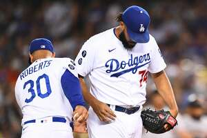 LOS ANGELES, CA - JULY 21: Los Angeles Dodgers pitcher Kenley Jansenis removed from the game by manager Dave Roberts after blowing a save during a MLB game against the San Francisco Giants on July 21, 2021 at Dodger Stadium in Los Angeles, CA.