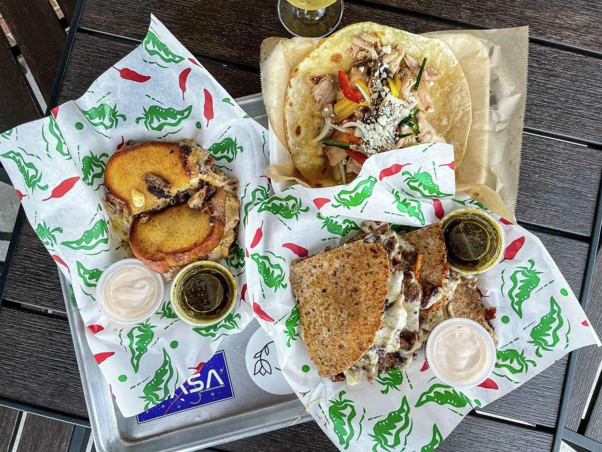 Smoked pork carnitas grilled cheese sandwich, smoked chicken taco, brisket quesadilla atEl Pobre Tex Mex BBQ trailer