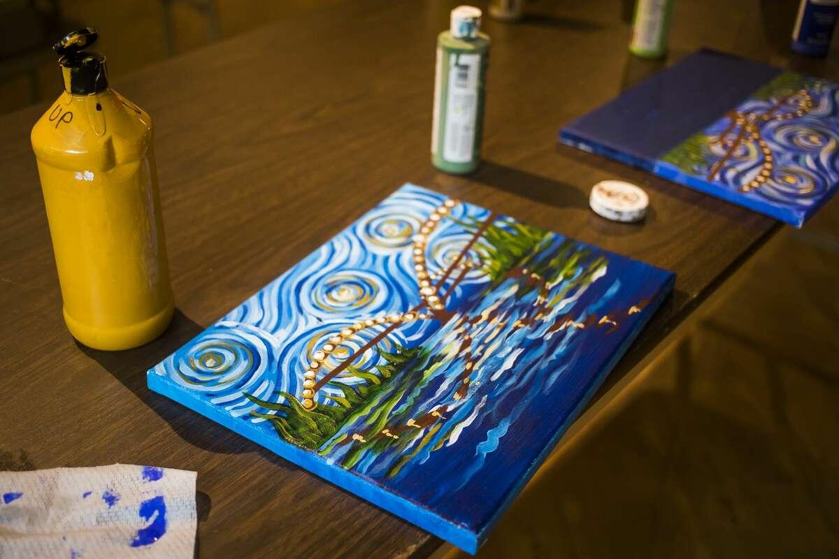 "Creative 360 Executive Director Laura Vosejpka leads a ""Starry Tridge"" painting class Wednesday, July 21, 2021 at the Midland Mall. (Katy Kildee/kkildee@mdn.net)"