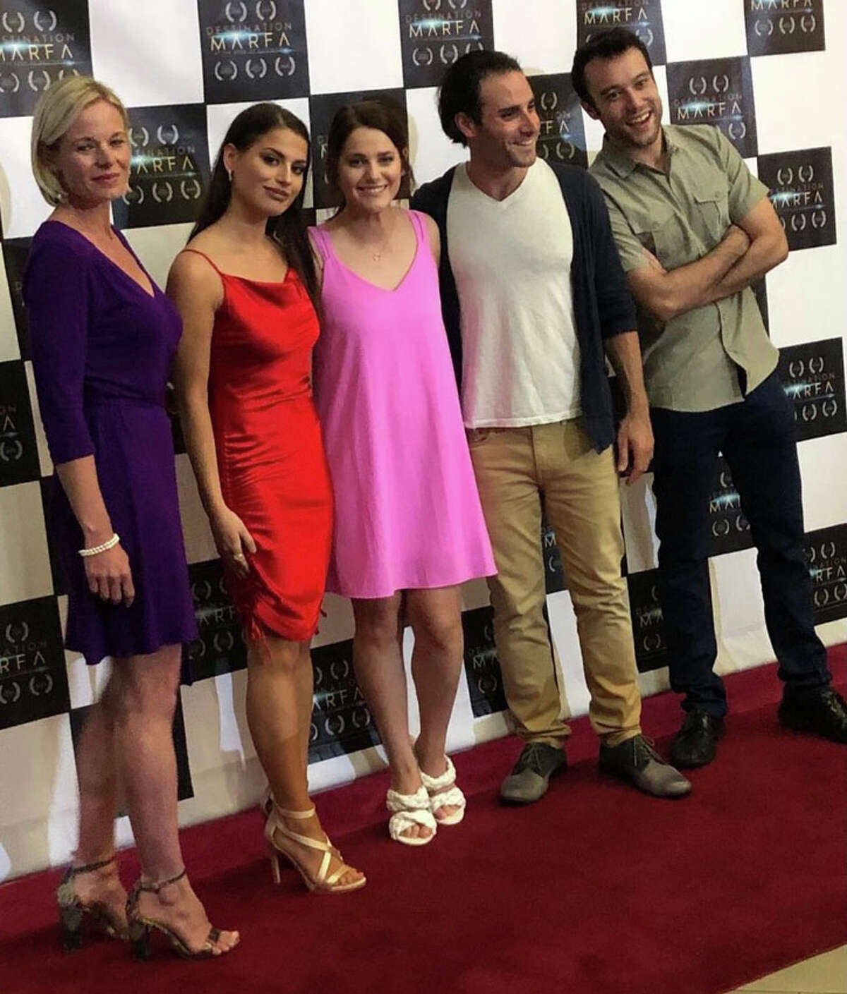 Cotton Center native Brittany Jo Alvarado (in red) played Eden Percell in the film. In pink his Brittany's sister Brandy.