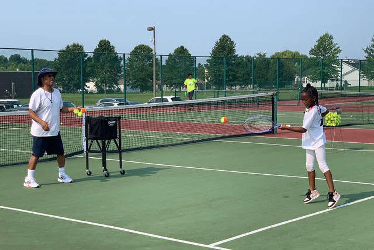 Bobby Johnson does a drill with Jaiden Coleman during Diversity Day for the Edwardsville Futures.