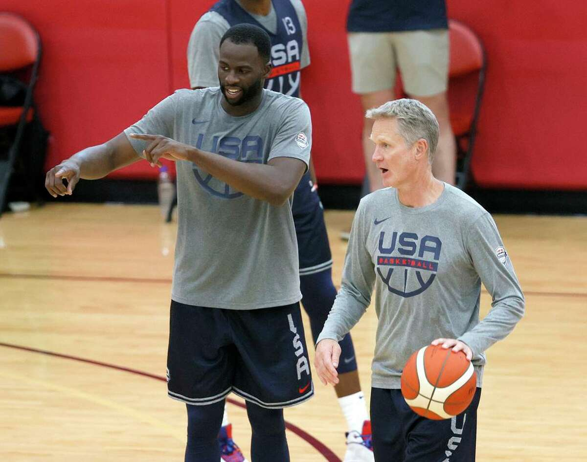 LAS VEGAS, NEVADA - JULY 07: Draymond Green (L) #14 and assistant coach Steve Kerr of the 2021 USA Basketball Men's National Team practice at the Mendenhall Center at UNLV as the team gets ready for the Tokyo Olympics on July 7, 2021 in Las Vegas, Nevada. (Photo by Ethan Miller/Getty Images)