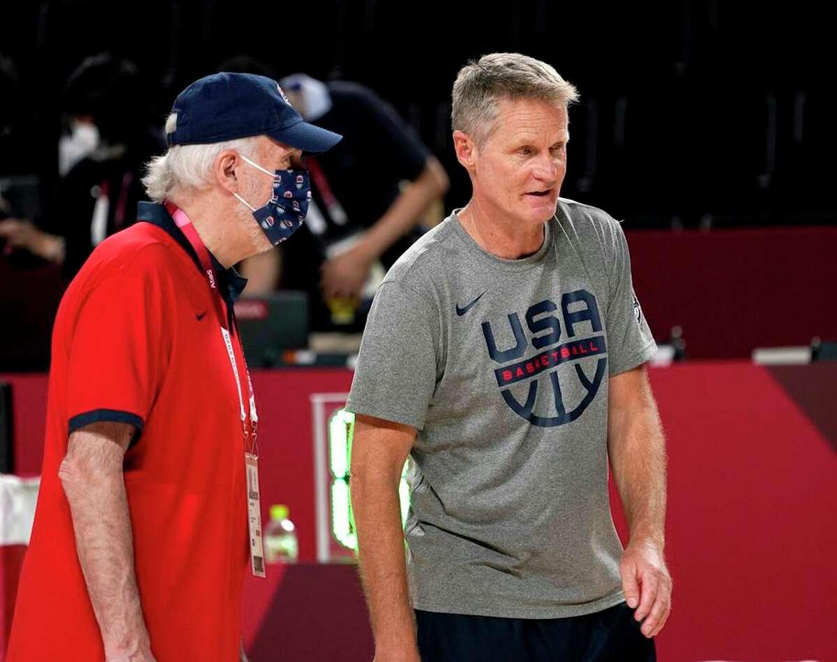 U.S. head coach Gregg Popovich (left) and assistant Steve Kerr confer.