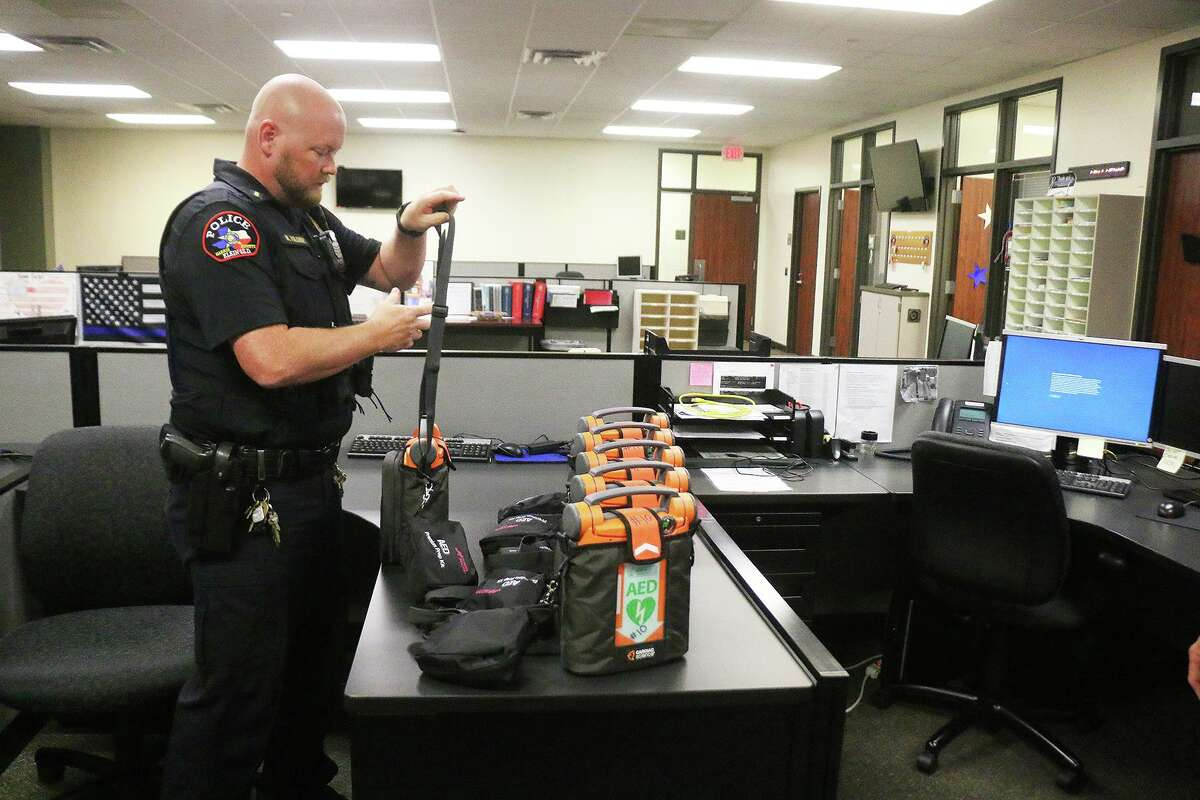 Lt. Nathan Polansky takes a look at one of the new automated external defibrillators delivered to the Klein ISD police department. Polansky is one of the AED instructors and trainer.