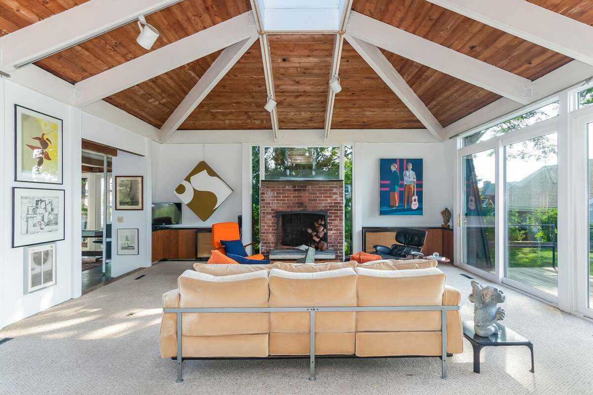 """The living room in the 105 Prospect Ave. home has high ceilings outfitted with a """"peaked skylight"""" and has doors leading out to an outdoor space. View listing"""
