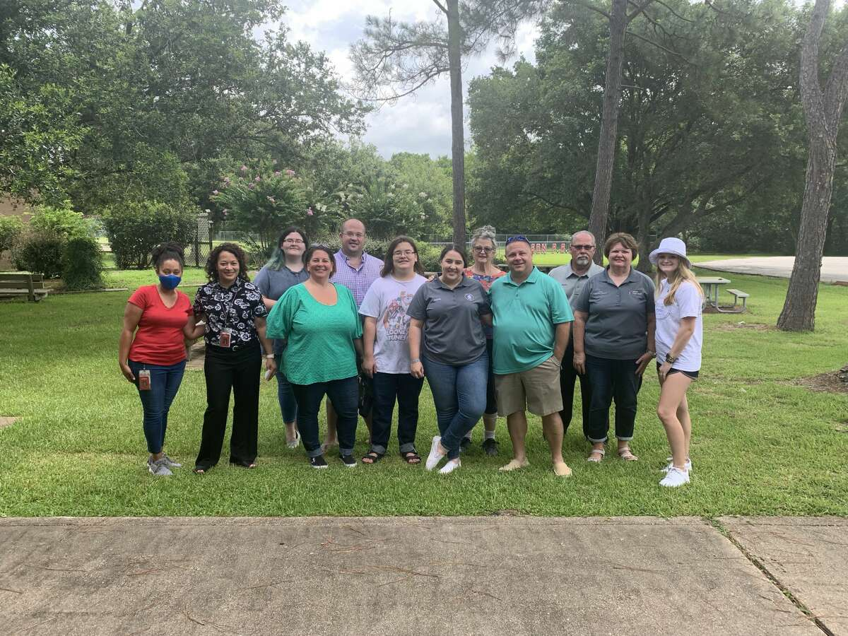 Lory's Legacy Foundation volunteers present 250 backpacks filled with supplies to E.C. Mason Elementary School July 15. Aubrey Middleton started the foundation earlier this year to continue a back-to-school outreach program established by her mother, Lory Middleton, who died in May.