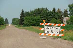 A road closed sign blocks the way for any traffic to go to a bridge on Dunn Road over the Pinnebog River. Bridge repair work by the Huron County Road Commission should take about a week. (Robert Creenan/Huron Daily Tribune)