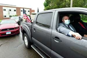 Branford First Selectman Jamie Cosgrove, left, and Ray Ingraham of Branford wait at Branford High School as they participate in a Memorial Day drive-by procession of vehicles May 25, 2020.