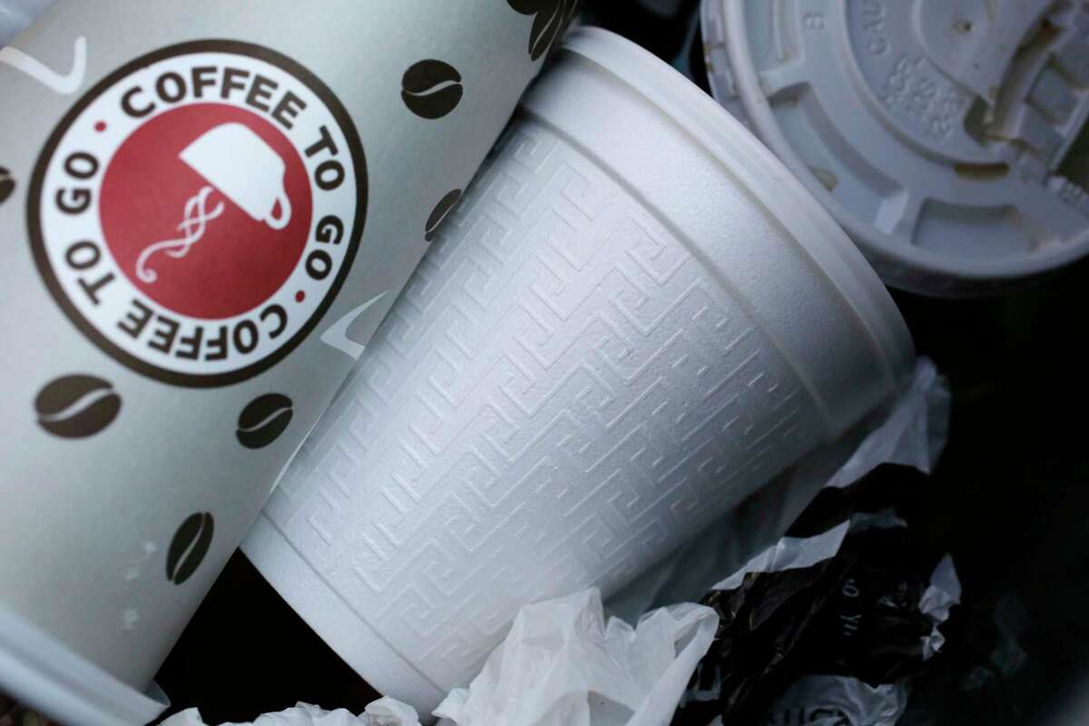 A foam cup, center, is discarded in a trash bin in New York Thursday, Feb. 14, 2013