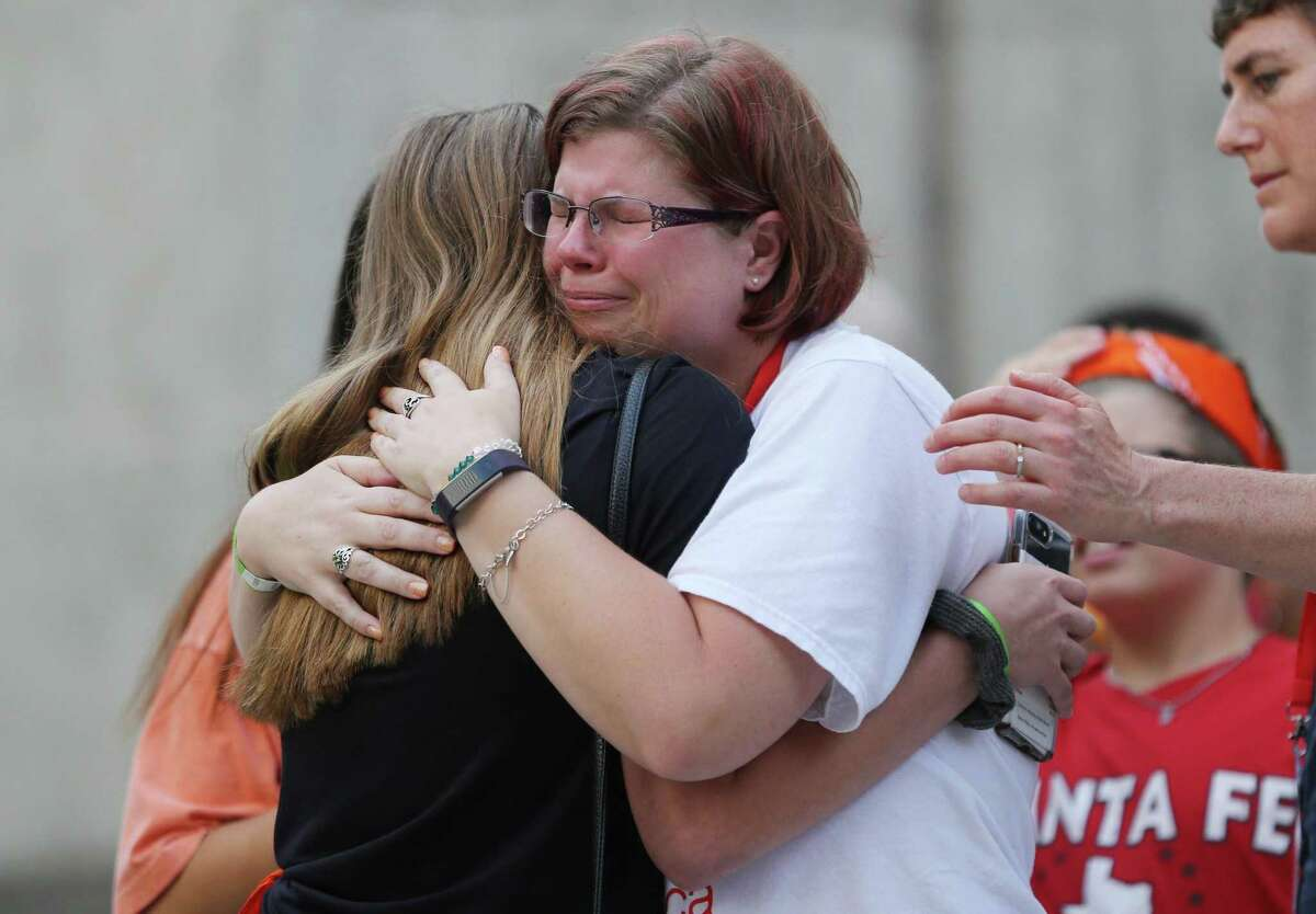 Rhonda Hart, whose daughter, Kimberly, was killed during the Santa Fe school shooting hugs student Esta O'Mara during the Road to Change tour stop at city hall on Sunday, July 8, 2018 in Houston. (Elizabeth Conley/Houston Chronicle)