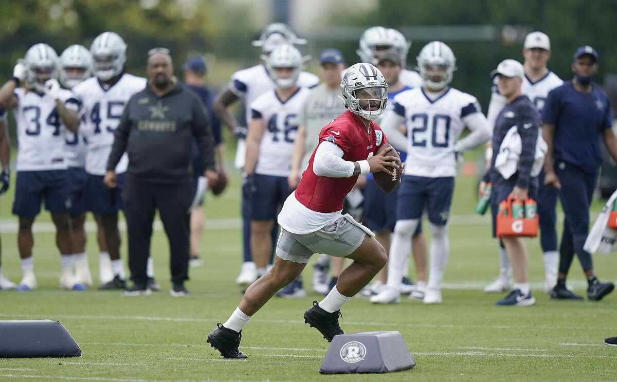 Dallas Cowboys quarterback Dak Prescott (4) runs a drill in front of teammates during an NFL football team practice Wednesday, June 9, 2021, in Frisco, Texas. (AP Photo/LM Otero)