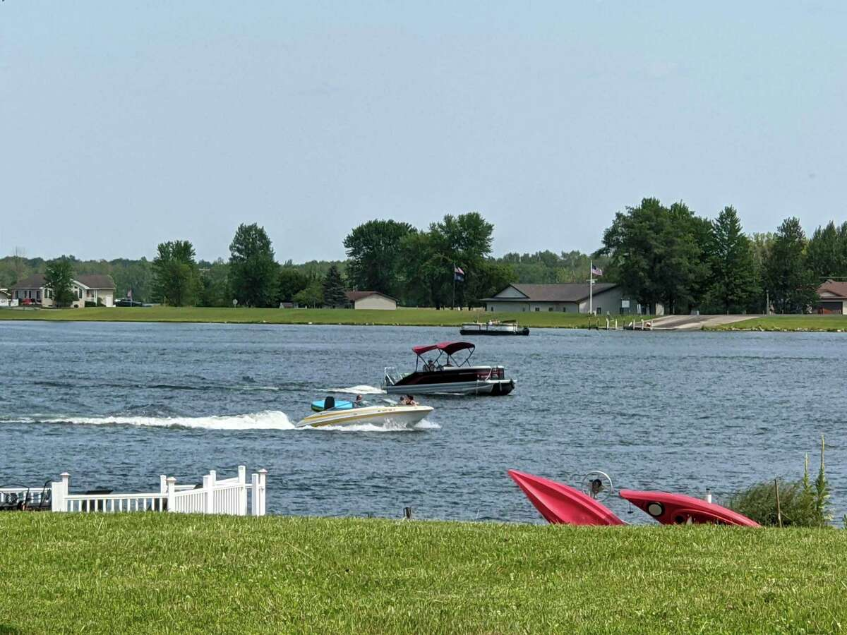 Some of the boating activity on Lake Lancer Saturday afternoon. Residents on Lake Lancer and Pratt Lake said there is increased boating, fishing and other water activities on the lakes and they would like the visitors obey the rules. They would also like to see more enforcement by marine patrol. (Photo by Tereasa Nims/for the Daily News)