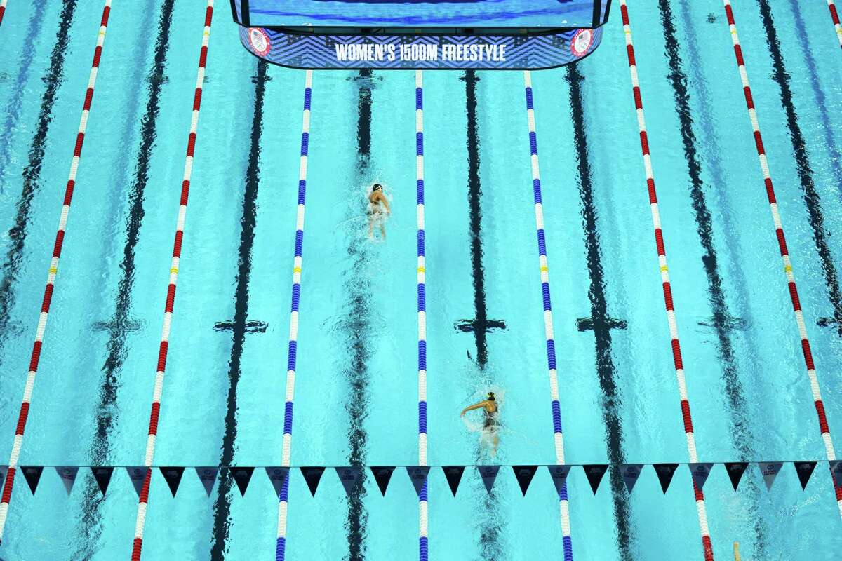 Katie Ledecky takes a large lead as she swims in a preliminary heat of the women's 15,00-meter event at the U.S. Olympic trials in June.